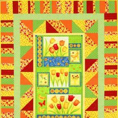 Idea for using pre-printed fabric panel....Tulip Time Panel Quilt