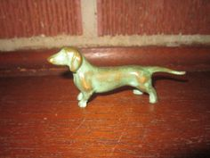 This 1 3/4 tall by 3 5/8 long cast metal Dachshund dog from an Iowa estate is in excellent condition with no problems as shown. International buyers