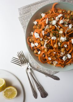 Moroccan Carrot Noodle Salad with Golden Raisins, Goat Cheese and Harissa - A Cozy Kitchen