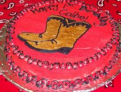 "boot - This was made for a family member. His parents are ranchers, and wanted something ""westerny"". I also made a cookie bouquet featuring hats, boots and horses."