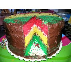 """Rasta cake! Super fun super easy! Made this today by just separating 2 boxes of yellow cake mix into 3 bowls. In the separate bowls I died them and then baked three 9"""" cakes. Put them all together with chocolate frosting between layers! So fun!"""