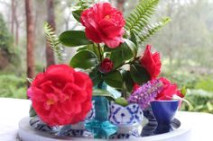 Make a meagher flower selection look more impressive with eggcups and a mirror