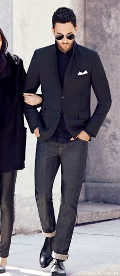 Noah Mills in a Navy Knit Jacket, Black Tee, Dark Skinny Jeans, and Black Leather 'Postal' Shoes. Men's Fall Winter Fashion.