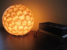 Coffee filter paper lantern - I don't have the patience for this, but it's still a neat idea - I assume you could build it on either a balloon or a exercise ball, leave an opening at the bottom and then deflate it to remove the ball