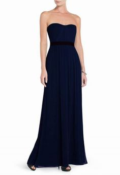 """$175.00 Redefine urban elegance in this structured yet floaty chiffon gown. Strapless. Classic fit.Sweetheart neckline with pleated detail. Cascade ruffle at skirt. Includes detachable shoulder straps.Concealed center back zipper with hook-and-eye closure. Measures approximately 52.75"""" from neckline to hem.Crinkle Chiffon: 100% Silk.Imported. Dry Clean."""