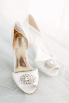 Classic jeweled white wedding shoes: Photography : Mike Cassimatis Read More on SMP: http://www.stylemepretty.com/missouri-weddings/st-louis/2016/01/25/classic-st-louis-opera-house-wedding/
