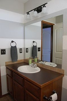 Grey and white bathroom like the striped walls