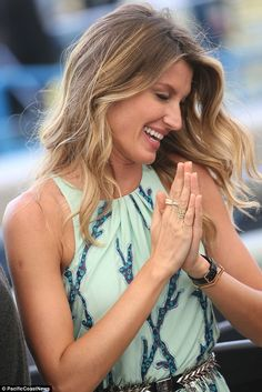 Glamming it up: She accessorized with numerous gold rings and a gold bracelet