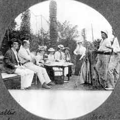 Black and white photo of middle-class Victorian people taking tea in a garden © Sheffield Libraries, Archives and Information