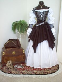 Renaissance Steampunk Costume but sub leather for the overskirt and cuffs
