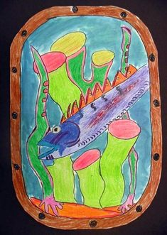 Third graders created an underwater scene from a porthole. We used black sharpies and crayons for the color and did a watercolor wash in blues and greens for the ocean water. This was a great chance for them to work on their observation skills as we used pictures to create this work.