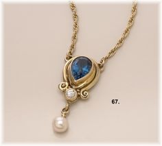 14Kt gold pendant with London Blue Topaz, .15ct Diamond & Pearl by Richelle Leigh Collection