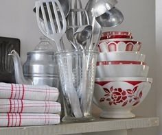 Kitchen in red. Photo from petitsdetails' Etsy shop (the glass measuring cup for sale).