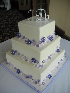 Purple Flowers Wedding Cake by pastrybitch