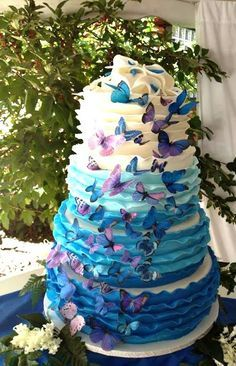 Beautiful Ombre Cake Ideas For All Occasions - Blue and Purple butterfly tier cake made by Carey's Cakery & Bake Shop | http://CraftyMorning.com