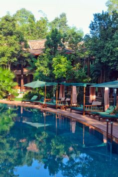 The stunning 820-foot pool winds like a river through the tropical gardens. Angkor Village Resort & Spa (Siem Reap, Cambodia) - Jetsetter