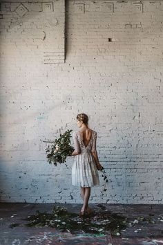 organic and industrial bridal inspiration photographed by Jess Hunter, Seattle warehouse wedding inspiration, warehouse indoor wedding with greenery decor, wild foraged bouquet ina Seattle wedding, rosemary floral crown bridal style, modern industrial wedding