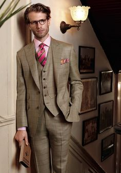 Paul Stuart - S/S 2014  I do not like that tie but th plaid suit is awesome.