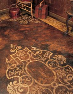 stained concrete.... Such an awesome idea! cool for a back patio too!