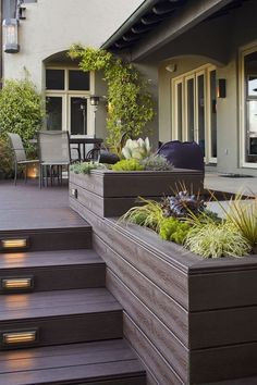 Contemporary Deck with Step light, Composite decking, Raised beds, French doors