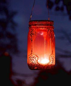 Handpainted Moroccan Mason Jar Lantern at www.dotandbo.com #upcycled #masonjar