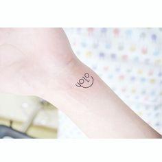 small YOLO tattoo