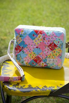 Darling bag finish by Minki Kim of Minki's Work Table. She created the bag pattern so that her daughter could have a good sized bag to take on playdates with friends. For the exterior, Minki used Backyard Roses fabric by Nadra Ridgeway of ellis & higgs for Riley Blake Designs , as well as Penny Rose Fabrics , and Lecien Fabrics for the interior, while starting to test the Aurifil 80wt appliqué thread. To see more, please visit: http://www.minkikim.com/claires-playdate-bag/