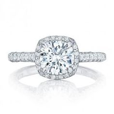 A cathedral setting, with both ceilings meeting at the crown for a stunning design that is sure to take her breath away. A unique cushion basket creates an illusion with a round center diamond for brilliance from every angle. Tacori HT2545CU7