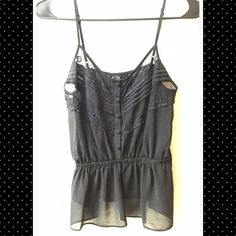 Sheer Lace Peplum Tank XS Black sheer tank with lace and button detail and peplum waist. Flowy and pretty, looks perfect on its own or under a cardigan. Size on the tag is small but it fits like an XS. Forever 21 Tops Camisoles
