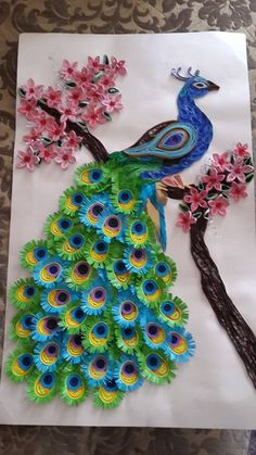 blue and orange peacock quilling piece in circle You are skilled (& patient!Stunning peacock made of quilled paper. Quilling is the art of paper rolling. Peacock Quilling, Peacock Crafts, Paper Quilling Patterns, Quilled Paper Art, Peacock Art, Quilling Paper Craft, Quilling Flowers, Paper Crafts, Quilling Ideas