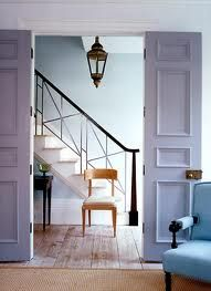 Lilac doors. Blue ascent. Wall and chair. Lovely palette.