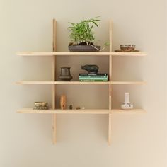 the simple grid locking shelves ++ el dot (could redo this with old pallet or reclaimed conduction scrap- Jz)