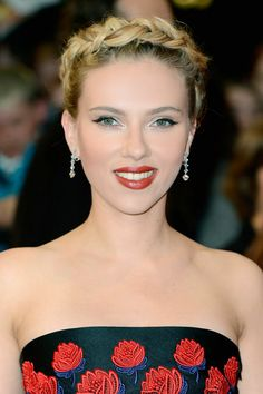 """A clean, braided up-do is a clever way to add not only femininity but also height to your hair. What keeps this look chic and not 'little-girl' is Scarlett's sexy, powerful red pout. This balance is critical for the hair look to work."""""""