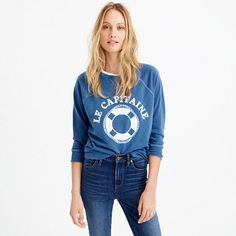 """Made in LA from garment-dyed cotton, this sweatshirt is sewn, then dyed, for a perfectly imperfect color that's a little more saturated around the seams—and will only gain more character with time. We added our own vintage-inspired nautical touch (see: """"le capitaine"""") because nothing says summer like sailing. <ul><li>Loose fit.</li><li>Cotton/poly.</li><li>Machine wash.</li><li>USA.</li></ul>"""