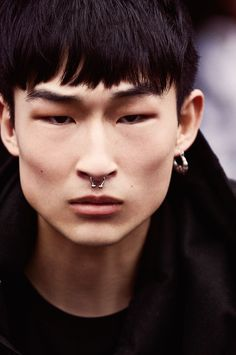 Armani Exchange model Sang Woo Kim delivers a close-up, showcasing his septum piercing.