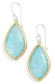 Perfect for everyday wear, these glistening drop earrings in turquoise and gold are sure to stand out.