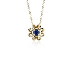 Stunning all over, this one-of-a-kind pendant showcases a rich blue sapphire gemstone wrapped in 14kt yellow gold. Simply perfect for everyday wear.