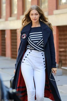 Aye, aye captain: Gigi looks all-American as she models pieces from her upcoming capsule collection with Tommy Hilfiger during a photoshoot in New York City