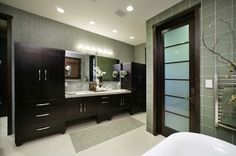 Master Bathroom, love the door and the taller cabinets beside the countertop.