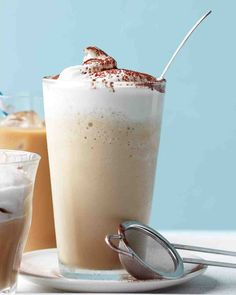 Coffee Frappe   ~  3 scoops vanilla ice cream,  1 cup ice,  1 cup chilled brewed coffee,  1/2 cup milk   2 tblsp Simple Syrup (see recipe),  whipped cream  &  cocoa powder.   Blend ice cream, ice, coffee, milk & simple syrup in blender until smooth.  Pour into tall glass.  Top with whipped cream. Dust with cocoa powder.