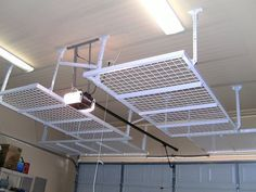 Garage Ceiling Storage Ideas | Overhead Storage Units are great for going over the garage door making ...