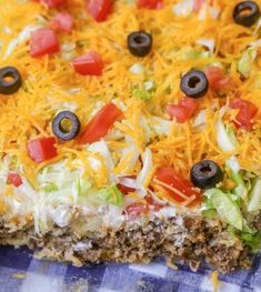 Delicious Taco Casserole that has a meat and biscuit base (sub out bells biscuits )and is topped with sour cream, lettuce, tomatoes, cheese and olives. Casserole Taco, Easy Casserole Recipes, Casserole Dishes, Mexican Casserole, Macaroni Recipes, Ground Beef Casserole, Chicken Casserole, Ground Beef Taco Dip, Taco Casserole With Tortillas
