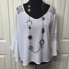 White Bell Sleeve Crinkle Flowy Top White, Bell sleeves, Crinkle fabric. Lace detail on shoulders and sleeves.  Size Small. Only worn twice.  EUC Absolutely Famous Tops Blouses