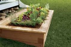 This is the next step we'd like to take with our garden--replace our old ones with some nice, durable wood with a nice platform on top to sit on. Now, to have enough money to do it....