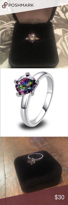 Christmas Rainbow Topaz in Sterling Silver Mystic Rainbow Topaz five prong in Sterling silver dazzles.                                              Mystic  topaz has a very interesting rainbow color, which changes as it is tilted. This is what sets it apart from other stones, since every single color can be seen in one kaleidoscopic and magical stone, depending on the exact colors used on the coating. The quality of mystic topaz gemstones is dependent on the quality of the raw material; in…