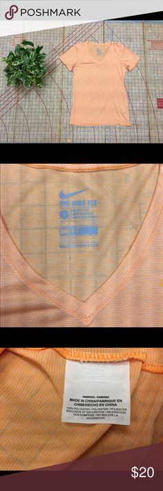 """Nike Drifit tee size small New Nike Drifit tee size small. Never worn. No tags. Orange and white microstripe. Looks like a pastel orange/peach color like orange sherbert. Will keep you just as cool too. Sheer. Satiny feel to fabric. Length is 24"""", chest is 17"""" across and sleeve is 7"""". Nike Tops Tees - Short Sleeve"""