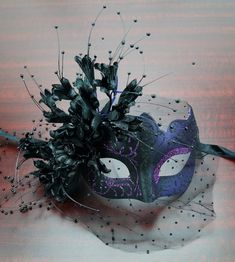 Masquerade Flower Mask Purple Italian Masquerade Masks A plastic mask with glitter trim, cluster of adjustable flowers with bead strings, and veil. Venetian Masquerade Masks, Masquerade Costumes, Masquerade Ball, Masquerade Party Outfit, Masquarade Mask, Dibujos Cute, Carnival Masks, Beautiful Mask, Masks Art