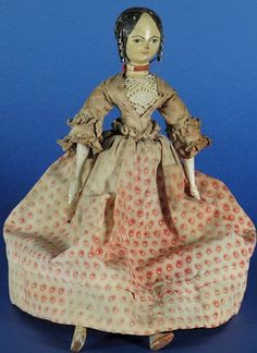 Grodnertal doll with carved ringlets.