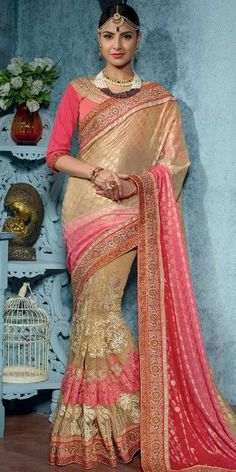 Fabulous Cream And Pink Georgette Net Saree With Blouse.