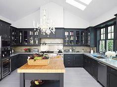 Just add stainless steel counter tops and red accents- perfection!